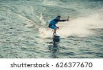 wakeboarder trains in the lake | Shutterstock . vector #626377670