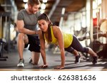 girl doing pushups with trainer'... | Shutterstock . vector #626381636