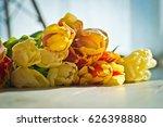 tulips on the shelf glasses book | Shutterstock . vector #626398880