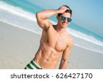 young muscular guy in striped... | Shutterstock . vector #626427170