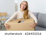 smiling young woman holding a... | Shutterstock . vector #626431016