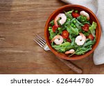 fresh green salad with tomatoes ... | Shutterstock . vector #626444780