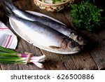 Stock photo salted herring with mashed potatoes and cucumber salad radish and cabbage with olive oil on an old 626500886