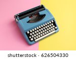 vintage blue typewriter over a... | Shutterstock . vector #626504330