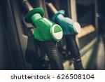 gasoline pump nozzles closeup...