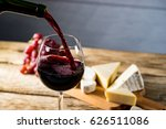 pouring red wine into the glass ... | Shutterstock . vector #626511086