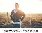 Cheerful Woman Athlete Standin...