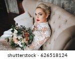 beautiful bride in a lace dress ... | Shutterstock . vector #626518124