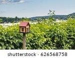 Wooden Bird House On Blue Sky...