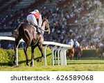 Stock photo horse races jockey and his horse goes towards finish line traditional european sport 626589068