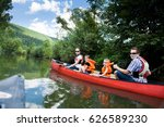 young family canoeing | Shutterstock . vector #626589230