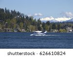 Seaplane Taking Off From Lake...