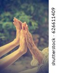 old and young holding hands.... | Shutterstock . vector #626611409