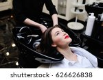 Stock photo beautiful young girl washing her head in a beauty salon 626626838