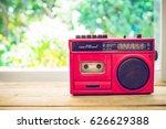 retro radio red color on table... | Shutterstock . vector #626629388