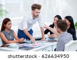 group of businesspeople looking ... | Shutterstock . vector #626634950