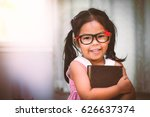happy asian little girl hugging ... | Shutterstock . vector #626637374