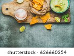 fresh guacamole sauce in blue... | Shutterstock . vector #626660354