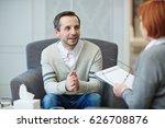 happy man looking at his... | Shutterstock . vector #626708876