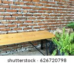 wooden bench with brick and... | Shutterstock . vector #626720798