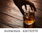 man's hand holding glass of... | Shutterstock . vector #626732570