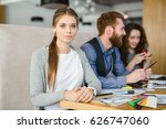 young woman sitting by... | Shutterstock . vector #626747060
