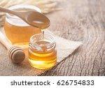 honey with wooden honey dipper... | Shutterstock . vector #626754833