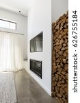 Small photo of Stacked firewood alcove next to living room tv and fireplace