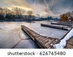 a wooden dock over a frozen... | Shutterstock . vector #626765480