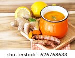a cup of turmeric tea with... | Shutterstock . vector #626768633