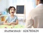 little boy and teacher on... | Shutterstock . vector #626783624