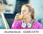 Blonde Young Woman Drink Orange ...