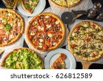 pizza on paper on a wooden... | Shutterstock . vector #626812589