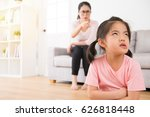asian mother sitting on the... | Shutterstock . vector #626818448