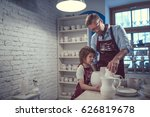 people in uniform in workshop | Shutterstock . vector #626819678