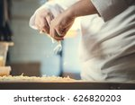 chef preparing pizza in kitchen | Shutterstock . vector #626820203