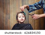 a little boy is trimmed in the... | Shutterstock . vector #626834150