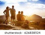 group of four friends enjoying... | Shutterstock . vector #626838524