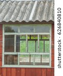 Small photo of window of cabin, tacky country old wooden small house, roof