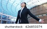 a woman in a suit  happy about... | Shutterstock . vector #626853374