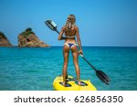 a sporty  slender  sexy  tanned ... | Shutterstock . vector #626856350