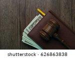 judge on folder with dollars
