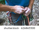 A Man Climber Untying The Knot...
