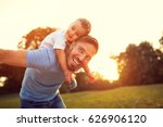 father piggyback his little son ... | Shutterstock . vector #626906120