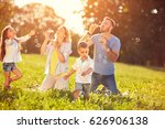 happy children with parents... | Shutterstock . vector #626906138