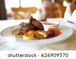 fresh steak on the table in... | Shutterstock . vector #626909570