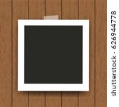 retro photo frame on wooden... | Shutterstock .eps vector #626944778