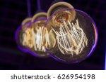 light bulbs in the dark close up | Shutterstock . vector #626954198