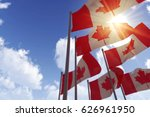 canada flags waving in the wind ... | Shutterstock . vector #626961950