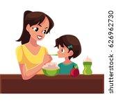 mother spoon feeding her little ... | Shutterstock .eps vector #626962730